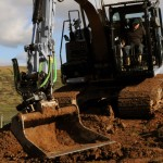 Picture grading bucket and tiltrotator in action on excavator